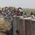 """FILE - In this April 29, 2013 file photo, migrants ride on top of a northern bound train toward the US-Mexico border in Union Hidalgo in Oaxaca, Mexico.  Al Jazeera America will air a series titled """"Borderland"""" which takes average Americans with strong opinions about illegal immigration through the same deadly journey that is taken by people trying to reach the U.S. The series premieres on April 13, 2014. (AP Photo/Eduardo Verdugo, File)"""