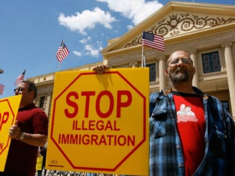 stop-illegal-immigration-sign-ap